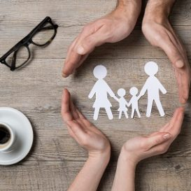 paper family and hands on the desk of a Fort Wayne family law attorney
