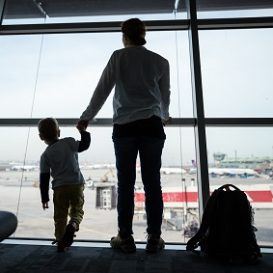 father and son waiting in airport for plane to arrive for son's scheduled visitation trip as determined with the help of a Fort Wayne visitation lawyer