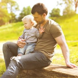 dad and son spending time in the summer after winning custody with a Fort Wayne paternity attorney
