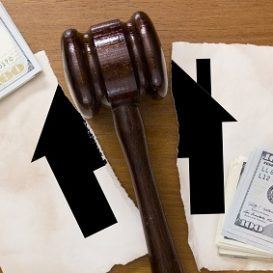 torn house and gavel on the desk of a Fort Wayne property division lawyer