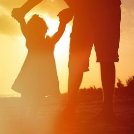 father and daughter walking on beach after meeting with Fort Wayne child support lawyers to discuss amounts