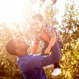 father and son playing together after the father met with Fort Wayne men's rights attorney to discuss custody